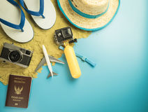 Summer travel Vacation fashion and gadgets on sand blue Royalty Free Stock Photo