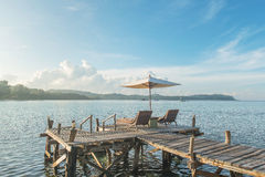 Summer, Travel, Vacation and Holiday concept - Beach chairs and Royalty Free Stock Photos