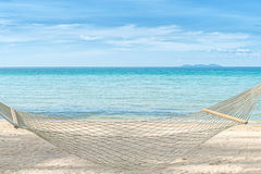 Summer, Travel, Vacation and Holiday concept - Empty hammock bet Stock Photo