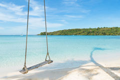 Summer, Travel, Vacation and Holiday concept - Swing hang from c Royalty Free Stock Photo