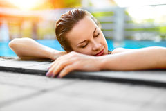 Summer Travel Vacation. Woman Relaxing In Pool. Healthy Lifestyl Royalty Free Stock Photography