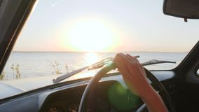 Summer travel on vehicle for Sweet feminine to river, Happy journey, Young woman at front seat of car on coast sea stock video