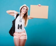 Summer traveler woman hitchhiking with blank sign Royalty Free Stock Images