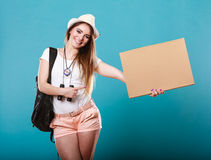 Summer traveler woman hitchhiking with blank sign Stock Image