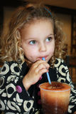 Summer Treats. Little girl drinking a frozen drink Royalty Free Stock Photos
