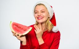 Summer treats on christmas party. Exotic christmas concept. Exotic winter vacation. Celebrate new year summer. Christmas. Girl eat watermelon. Girl wear santa stock photos