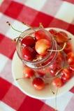 Summer treats.Rainier cherries. Summer rainier cherries in a glass bowl on a tablecloth. Sweet treats Stock Image