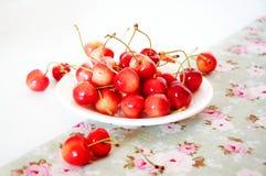 Summer treats.Rainier cherries. Summer rainier cherries on a plate on a tablecloth. Sweet treats Royalty Free Stock Images
