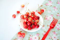 Summer treats.Rainier cherries. Summer rainier cherries on a platel on a tablecloth. Sweet treats Stock Photography