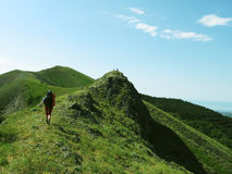 Summer trekking. People in the green mountain Royalty Free Stock Photography