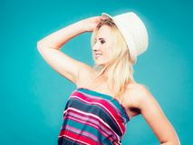 Blonde woman wearing colorful striped strapless shirt. Summer trendy fashionable outfit ideas concept. Blonde woman wearing colorful striped strapless shirt and Stock Image