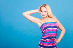 Blonde woman wearing short colorful striped dress Royalty Free Stock Photography