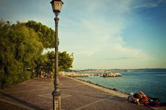 Summer in Trieste, Italy. Trieste, Barcola sea promenade at sunset, people enjoy the summer warm weather Royalty Free Stock Photo