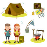 Summer trip with tents, pot in the forest. Tourists with backpacks and dinner at the stake. Stock Photography
