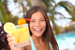 Summer tropical cocktail drink at pool party woman Stock Photos