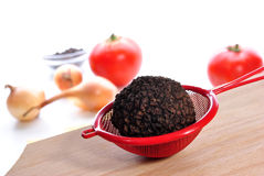 Summer truffle in a small sieve Royalty Free Stock Image