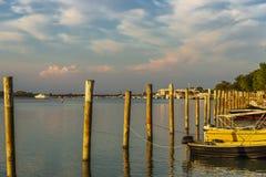 Summer twilight over the lagoon shoreline in Bibiobe, venice. Summer sunset over the lagoon water and shoreline inside Bibione, Venice royalty free stock photo
