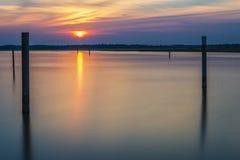 Summer twilight over the lagoon shoreline in Bibiobe, venice. Summer sunset over the lagoon water and shoreline inside Bibione, Venice stock image