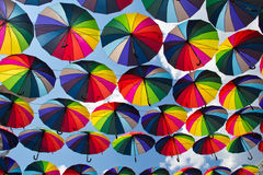 Summer Umbrellas at Arkadia Alley. Colorful umbrellas flying in the summer blue sky Royalty Free Stock Image