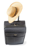 Summer vacation. Straw hat on packed travel case Stock Photography