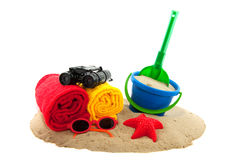 Summer vacation. At the beach with towels and toys Stock Photos