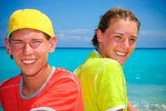 Summer vacation. Teens together on sunny beach in Cancun Stock Photo