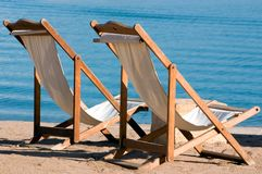 Summer vacation. Two empty seats on the beach Royalty Free Stock Photography