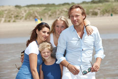 Summer vacation. Young attractive family enjoying their summer by the seaside Stock Images