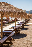 Summer Vacation Abstract. Umbrellas and sumbeds in a row Royalty Free Stock Photos