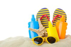Summer vacation accessories in clear sea sand isolated on white background. Summer vacation stock photography