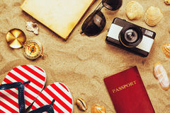 Summer vacation accessories on tropical sandy ocean beach, holid Royalty Free Stock Photo