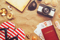 Summer vacation accessories on tropical sandy ocean beach, holidays abroad. Summertime lifestyle objects and Great Britain pounds in flat lay top view royalty free stock photo