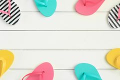 Summer vacation background with colorful flip flops stock photos