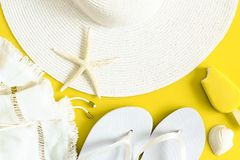 Summer vacation background of hat, flip flops, shells and ice cream stock photography
