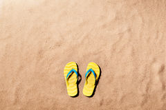 Summer vacation background with a pair of flip flop sandals. Stock Photo