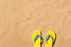 Summer vacation background with a pair of flip flop sandals. Royalty Free Stock Photos