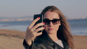 Summer vacation beach travel. Technology and people concept with smiling woman making selfie with smartphone on beach stock video footage