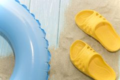 Summer vacation on the beach. Yellow flip-flops and swimming laps. Summer vacation on the beach. Yellow flip-flops and swimming laps stock photos