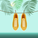 Summer vacation on the beach. Yellow sneakers on the background of palm branches and the sea vector illustration