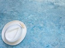 Summer vacation, blue background in the form of the sea, hat, shells stock photography