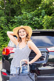 Summer vacation car road trip freedom concept. Happy woman cheering joyful during holiday travel with car. Stock Photos