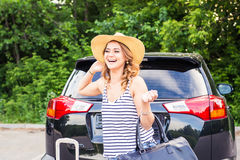 Summer vacation car road trip freedom concept. Happy woman cheering joyful during holiday travel with car. Stock Photo