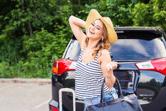 Summer vacation car road trip freedom concept. Happy woman cheering joyful during holiday travel with car. Royalty Free Stock Photos