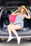 Summer vacation car road trip freedom concept. Happy woman cheering joyful during holiday travel with car. Royalty Free Stock Image