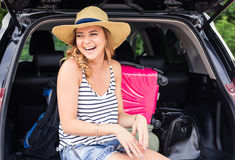 Summer vacation car road trip freedom concept. Happy woman cheering joyful during holiday travel with car. Stock Photography