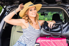 Summer vacation car road trip freedom concept. Happy woman cheering joyful during holiday travel with car. Stock Image
