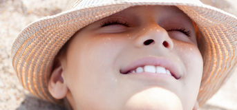 Summer vacation child face happy smile. Close up straw hat outdoor Stock Images