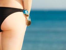 Summer vacation. Closeup female buttocks on beach Stock Photography