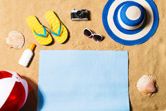 Summer vacation composition. Sandals, hat and beach ball. Stock Photography