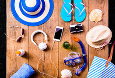 Summer vacation composition. Sandals, hat and other stuff, woode Royalty Free Stock Photo